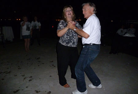 Rock 'n' Roll! Stuntman Lou Elias (James Stacy's brother) dances at the pool party with Lacy Barras.