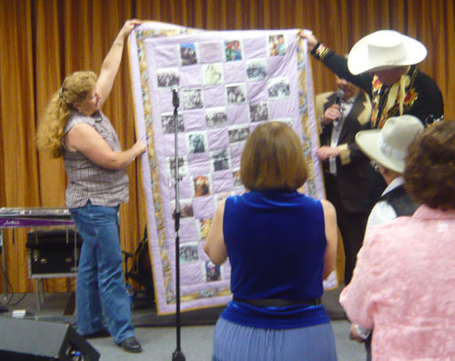 "Donna Wilmeth presented her handmade Roy Rogers/Dale Evans quilt to Dusty Rogers at the end of the banquet. The ever gracious Donna handmade several other quits representing stars attending the festival and they were auctioned off to raise money for ""A Gathering of Guns 4"" May 31- June 2, 2012."