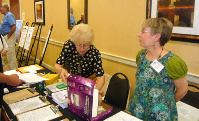 "Dottie McCollum and Donna Nielsen worked hard at the festival registration desk and say, ""We'll see you next year."""