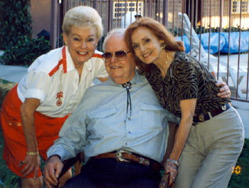 Arizona Cowboy Rex Allen surrounded by two of his Republic leading ladies, Lyn Thomas (left) and Mary Ellen Kay during Rex Allen Western Days in Wilcox, AZ, in October 1999.