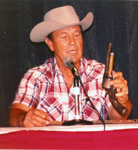 "Don (""Johnny Ringo"") Durant explains the working of his seven-shooter LeMat at the Charlotte, NC, Western Film Fair in 1991."