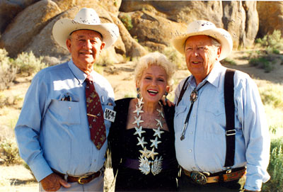 "Out amongst the Alabama Hills of Lone Pine, California, Jimmy Rogers (son of Will Rogers), the late Grace Bradley Boyd (Mrs. Hoppy) and Rand (""Lucky"") Brooks."