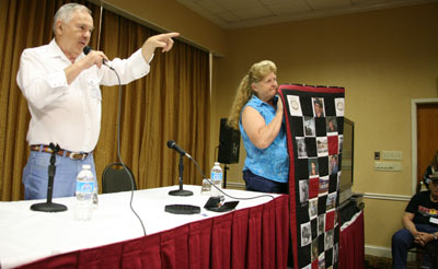 "Prior to the ""Virginian"" panel Boyd Magers auctioned off a beautiful quilt made by Donna Wilmeth who holds it for the audience to see."