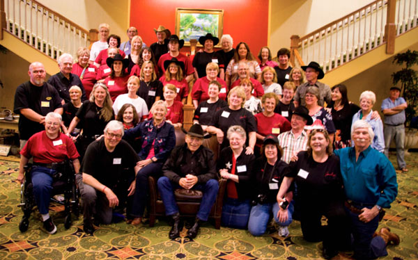 "The cast of ""The Virginian"" surrounded by The Virginian Posse who turned out for the 50th anniversary of the series. (Front row l-r): Chris Braning, Ron Frederickson, Roberta Shore, James Drury, Karen Lindsey, Kelly Lucey,Pamela LeBaugh, L. Q. Jones. (Second row l-r): Jeff Mullins, Jan Glass, Nell Moore, Jennifer Glass, Sharon Klopfenstein, Patricia Prior, Sue Ketchum, Barb May, Jeannie Pugn, Randy Boone. (Third row l-r): Gary Clarke, Stephanie Landry, Mikki Shade, Sharon Schuman, Debbie Johnson, Susan Proctor, Don Quine, Tina Edmonds, Leta Burns, Sara Lane, Diane Roter, Juanita Smith. (Fourth row l-r): Alice Kunreuther, Sharon Landry, Lyn Beiler, Brad Schuman, Terry Bryant, Jeanne Irvine, Renee Jensen, Debbie Wilson, Terri Watson. (Fifth row l-r): Jeanette Wriston, Lynne Mercer, Jerry Klopfenstein, Lynn Kvalheim, Nic Fewer. Standing off to the right of the photo is Patie O'Sullivan."