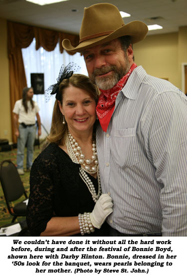 We couldn't have done it without all the hard work before, during and after the festival of Bonnie Boyd, shown here with Darby Hinton. Bonnie, dressed in her '50s look for the banquet, wears pearls belonging to her mother.  (Photo by Steve St. John.)