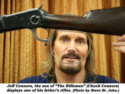 "Jeff Connors, the son of ""The Rifleman"" (Chuck Connors) displays one of his father's rifles.  (Photo by Steve St. John.)"
