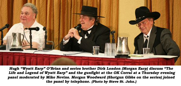 "Hugh ""Wyatt Earp"" O'Brian and series brother Dirk London (Morgan Earp) discuss ""The Life and Legend of Wyatt Earp"" and the gunfight at the OK Corral at a Thursday evening panel moderated by Mike Nevins. Morgan Woodward (Shootgun Gibbs on the series) joined the panel by telephone.  (Photo by Steve St. John.)"