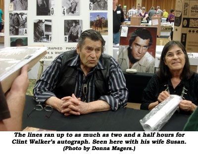 The lines ran up to as much as two and a half hours for Clint Walker's autograph. Seen here with his wife Susan.  (Photo by Donna Magers.)