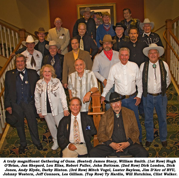 A truly magnificent Gathering of Guns. (Seated) James Stacym, William Smith. (1st Row) Hugh O'Brian, Jan Shepard, Lou Elias, Robert Fuller, John Buttram. (2nd Row) Dirk London, Dick Jones, Andy Klyde, Darby Hinton. (3rd Row) Mitch Vogel, Luster Bayless, Jim D'Arc of BYU, Johnny Western, Jeff Connors, Les Gilliam. (Top Row) Ty Hardin, Will Hutchins, Clint Walker.