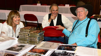 "Rudy Ramos' wife Kathy shares a smile with Rudy and Don Collier, Wind and forman Sam Butler of ""High Chaparral""."