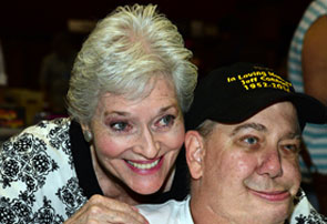 Gracious Lee Meriwether poses with a fan.