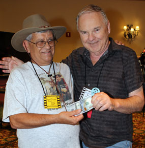 Don Ellis, Trivia Contest winner three years in a row, accepts his $100 prize from WC's Boyd Magers.
