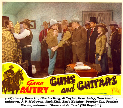 "(L-R) Smiley Burnette, Charles King, Al Taylor, Gene Autry, Tom London, unknown, J. P. McGowan, Jack Kirk, Earle Hodgins, Dorothy Dix, Frankie Marvin, unknown. ""Guns and Guitars"" ('36 Republic)."