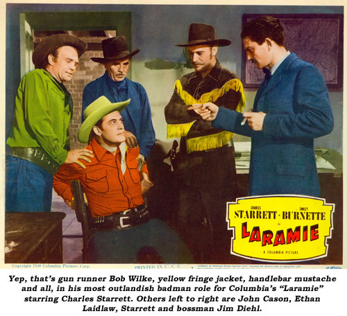 "Yep, that's gun runner Bob Wilke, yellow fringe jacket, handlebar mustashe and all, in his most outlandish badman role for Columbia's ""Laramie"" starring Charles Starrett. Others left to right are John Cason, Ethan Laidlaw, Starrett and bossman Jim Diehl."