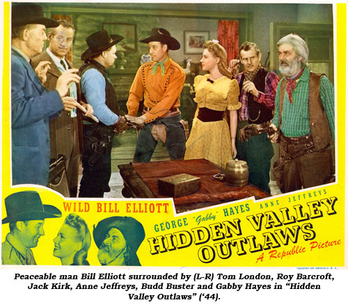 "Peaceable man Bill Elliott surrounded by (L-R) Tom London, Roy Barcroft, Jack Kirk, Anne Jeffreys, Budd Buster and Gabby Hayes in ""Hidden Valley Outlaws"" ('44)."