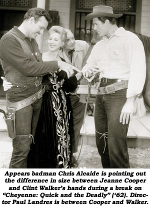 "Appears badman Chris Alcaide is pointing out the difference in size between Jeanne Cooper and Clint Walker's hands during a break on ""Cheyenne: Quick and the Deadly"" ('62). Director Paul Landres is between Cooper and Walker."