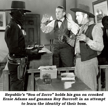 "Republic's ""Son of Zorro"" holds his gun on crooked Ernie Adams and gunman Roy Barcroft in an attempt to learn the identity of their boss."