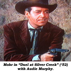 "Mohr in ""Duel at Silver Creek"" ('52) with Audie Murphy."