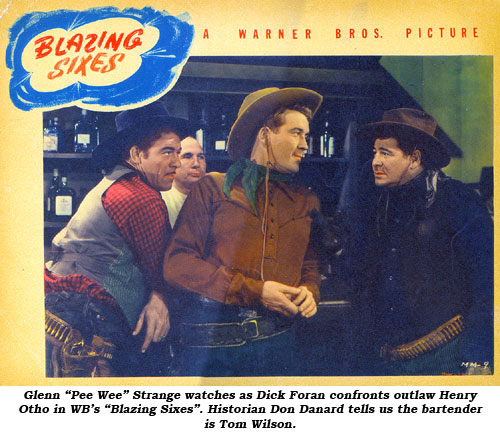 "Glenn ""Pee Wee"" Strange watches as Dick Foran confronts outlaw heanchman Henry Otho in WB's ""Blazing Sixes""."