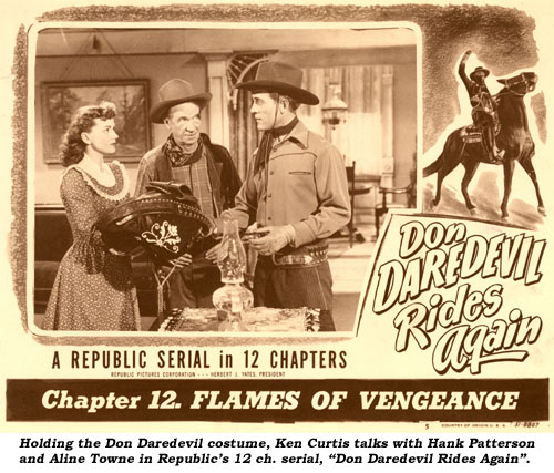 "Holding the Don Daredevil costume, Ken Curtis talks with Hank Patterson and Aline Towne in Republic's 12 ch. serial ""Don Daredevil Rides Again""."