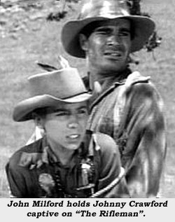 "John Milford holds Johnny Crawford captive on ""The Rifleman""."