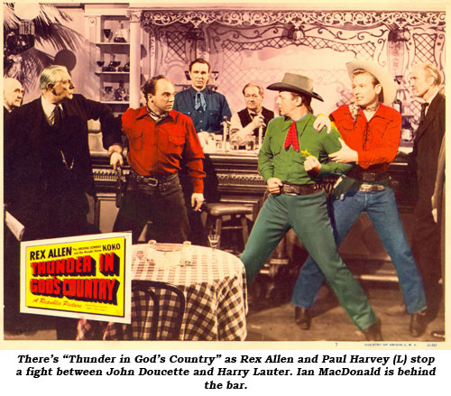 "There's ""Thunder in God's Country"" as Rex Allen and Paul Harvey (L) stop a fight between John Doucette and Harry Lauter. Ian MacDonald is bhind the bar."