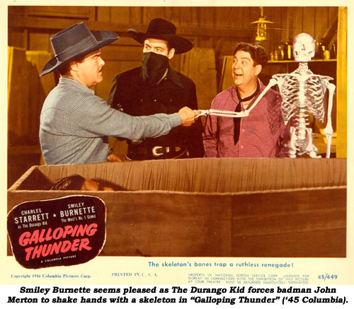 "Smiley Burnette seems pleased as The Durango Kid forces badman John Merton to shake hands with a skeleton in ""Galloping Thunder"" ('45 Columbia)."