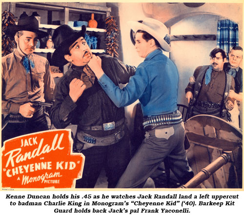 "Kenne Duncan holds his .45 as he watches Jack Randall land a left uppercut to badman Charlie King in Monogram's ""Cheyenne Kid"" ('40). Barkeep Kit Guard holds back Jack's pal Frank Yaconelli."