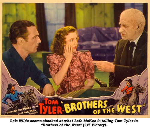 "Lois Wilde seems shocked at what Lafe McKee is telling Tom Tyler in ""Brothers of the West"" ('37 Victory)."