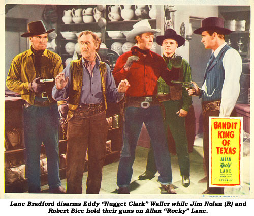 "Lane Bradford disarms Eddy ""Nugget Clark"" Waller while Jim Nolan (r) and Robert Bice hold their guns on Allan ""Rocky"" Lane in the scene card from ""Bandit King of Texas""."