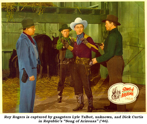"Roy Rogers is captured by gangsters Lyle Talbot, unknown and Dick Curtis in Republic's ""Song of Arizona"" ('46)."