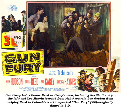 "Phil Carey holds Donna Reed as Carey's men, including Neville Brand (to the left) and Lee Marvin (second from right) restrain Leo Gordon from helping Reed in Columbia's action-packed ""Gun Fury"" ('53)--originally filmed in 3-D."