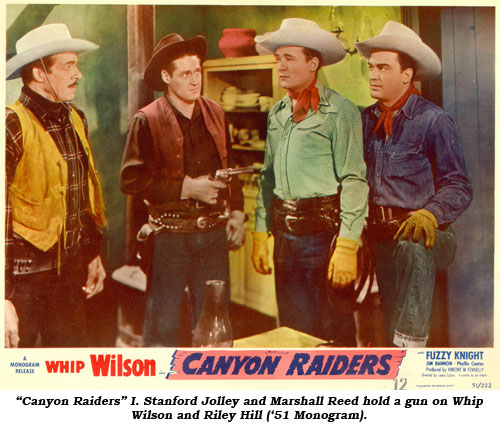 """Canyon Raiders"" I. Stanford Jolley and Marshall Reed hold a gun on Whip Wilson and Riley Hill ('51 Monogram)."