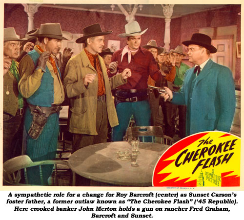 "A sympathetic role for a change for Roy Barcroft (center) as Sunset Carson's foster father, former outlaw known as ""The Cherokee Flash"" ('45 Republic). Here crooked banker John Merton holds a gun on rancher Fred Graham, Barcroft and Sunset."