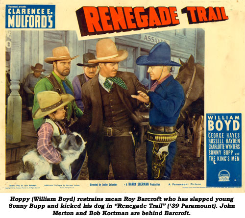 "Hoppy (William Boyd) restrains mean Roy Barcroft who has slapped young Sonny Bupp and kicked his dog in ""Renegade Trail"" ('39 Paramount). John Merton and Bob Kortman are behind Barcroft."
