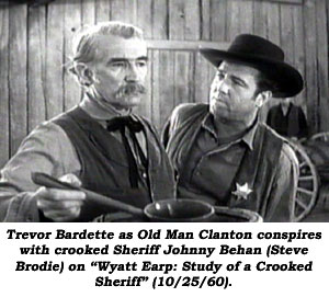 "Trevor Bardette as Old Man Clanton conspires with crooked Sheriff Johnny Behan (Steve Brodie) on ""Wyatt Earp: Study of a Crooked Sheriff"" (10/25/60)."