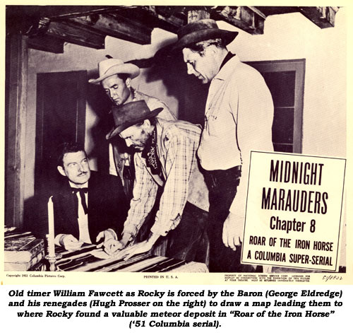 "Old timer William Fawcett as Rocky is forced by the Baron (George Eldredge) and his renegades (Hugh Prosser on the right) to draw a map leading them to where Rocky found a valuable meteor deposit in ""Roar of the Iron Horse"" ('51 Columbia serial)."