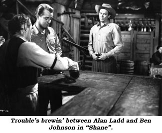 "Trouble's brewin' between Alan Ladd and Ben Johnson in ""Shane""."