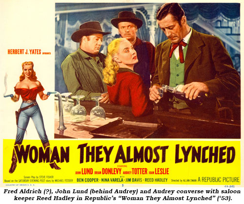 "John Lund (behind Audrey) and Audrey converse with saloon keeper Reed Hadley in Republic's ""Woman They Almost Lynched"" ('53)."