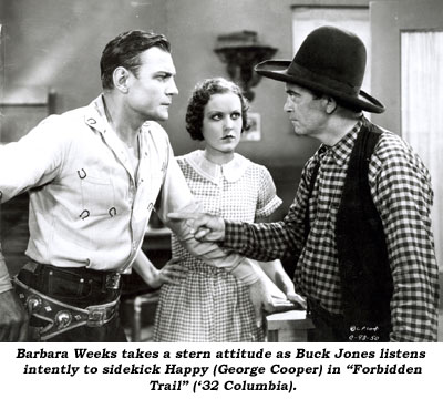 "Barbara Weeks takes a stern attitude as Buck Jones listens intently to sidekick Happy (George Cooper) in ""Forbidden Trail"" ('32 Columbia)."