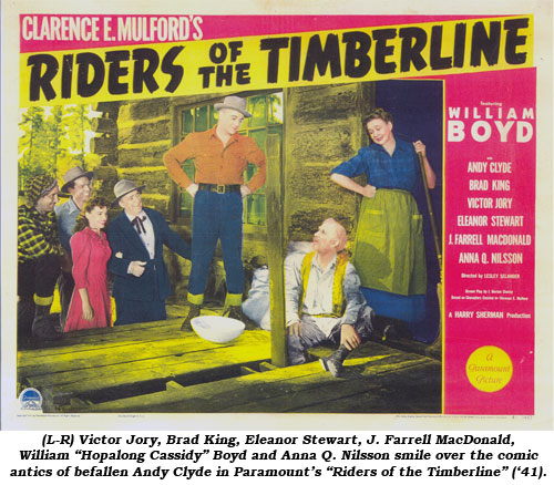 "(L-R) Victor Jory, Brad King, Eleanor Stewart, J. Farrell MacDonald, William ""Hopalong Cassidy"" Boyd and Anna Q. Nilsson smile over the comic antics of befallen Andy Clyde in Paramount's ""Riders of the Timberline"" ('41)."