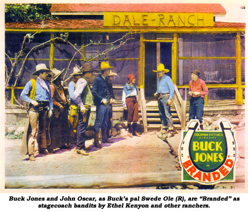 "Buck Jones and Oscar, as Buck's pal Swede Ole (R), are ""Branded"" as stagecoach bandits by Ethel Kenyon and other ranchers."