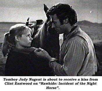 "Tomboy Judy Nugent is about to receive a kiss from Clint Eastwood on ""Rawhide: Incident of the Night Horse""."