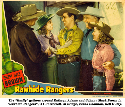 "The ""family"" around Kathryn Adams and Johnny Mack Brown in ""Rawhide Rangers"" ('41 Universal). Al Bridge, Frank Shannon, Nell O'Day."