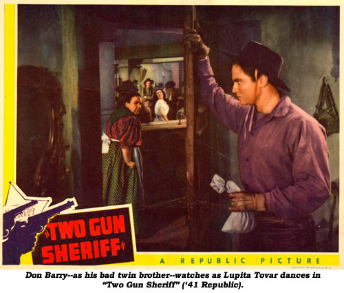 "Don Barry--as his bad twin brother--watches as Lupita Tovar dances in ""Two Gun Sheriff"" ('41 Republic)."