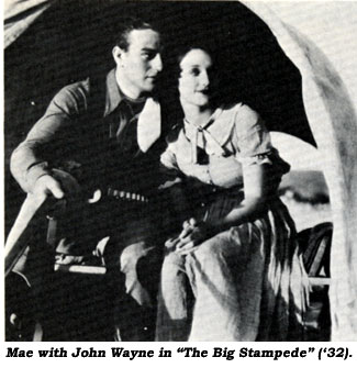 "John Wayne holds Mae's hand in Warner Bros.' ""The Big Stampede"" ('32)."