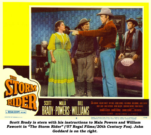 "Scott Brady is stern with his instructions to Mala Powers and William Fawcett in ""The Storm Rider"" ('57 Regal Films/20th Century Fox). John Goddard is on the right."