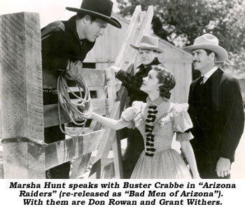 "Marsha Hunt speaks with Buster Crabbe in ""Arizona Raiders"" (re-released as ""Bad Men of Arizona""). With them are Don Rowan and Grant Withers."