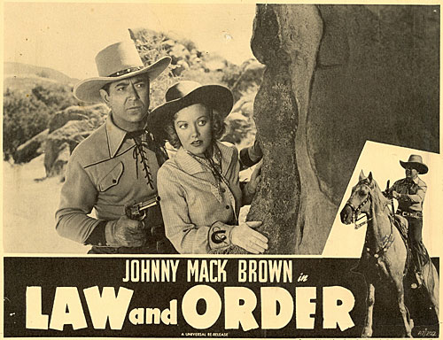 "Title card for ""Law and Order"" starring Johnny Mack Brown and Nell O'Day."