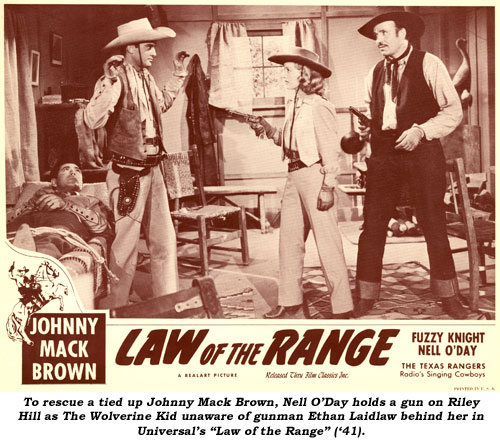 "To rescue a tied up Johnny Mack Brown, Nell O'Day holds a gun on Riley Hill as The Wolverine Kid, unaware of gunman Ethan Laidlaw behind her in Universal's ""Law of the Range"" ('41)."